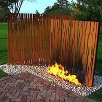 laser-cut-corten-steel-behind-fire
