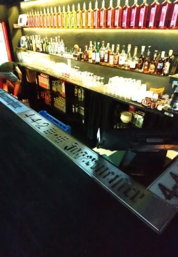 Спил-стоп для Минского бара из нержавейки с нанесением рекламных логотипов.